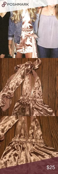 Pink romper Ink romper - like new - only worn once - have fun tying this romper is so many ways ! LF Dresses Mini