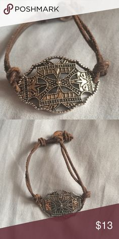 Brown Bracelet with Detailed Pendant Faux leather bands and a beautiful silver pendant with a lot of detail! American Eagle Outfitters Jewelry Bracelets
