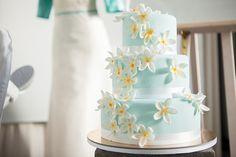 Mint wedding cake with frangipani flowers