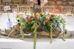 A stunning top table design on one of our specially imported Scandinavian Root pieces. The kiln dried natural wood works so well against the stone walls of Priston Mill. Bristol Florists, The Wilde Bunch at Priston Mill. Green Wedding, Our Wedding, Wedding Flowers, Stone Barns, Florists, Bristol, Natural Wood, Scandinavian, Walls