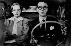 "Peggy Cummins as Annie Laurie Starr and John Dall as Bart Tare in ""Gun Crazy,"" King Brothers Productions 1950. Laurie and Bart are approaching a police checkpoint in this scene. They've just changed clothes and cars after robbing a bank. The robbery, filmed in real time from the backseat of the couple's previous car, is one of the most brilliant long takes in film history."
