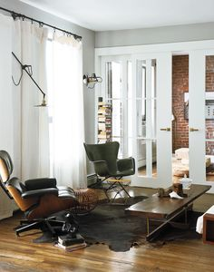 The Eames Lounge sits across a fiberglass chair designed by Richard Conover in this Brooklyn home.