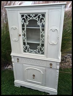 China hutch painted in Old White and distressed. So Pretty!
