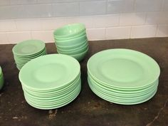 $160 Lovely dinnerware set of Jadeite dinnerware set from Anchor Hocking. Not vintage, but discontinued service sold through Vermont Country Store. Set includes in perfect condition 11 dinner plates, 11 salad plates, 12 saucers and 11 cups (large, hold 10 ounces of liquid). Also includes 7 cereal bowls which have chipping. Diswasher and microwave proof. Original value of the set was over $400.