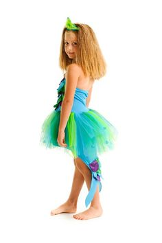 SPLASH MERMAID DRESS - LARGE -  A halter neck mermaid dress with scales of sparkle and satin. The dress has a lovely tail and is finished with a sparkling starfish. Made using the softest of fabrics and designed to play in.Generally the medium fits ages 4-6 years old, depending the the child's size.  $39.99