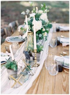 Bare wood table with a silk runner, soft florals, potted plants and gold details. Event design by Love & Honey, florals by Nectar. Image by Allison Kuhn Photography.