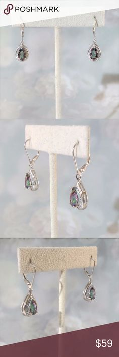 "Mystic Gemstone Earrings The 6x9mm pear cut mystic gemstones are 4 carats tw. They exhibited a rainbow color effect which changes from green, blue, purple as they shift while dangling. Treatment, coated.  Each earring has one 0.9mm genuine diamond accent.  The total drop length from top of the earwire is 1-1/4"". This exquisite pair of sterling silver lever back earrings will be a favorite to wear!  New in gift box.  Measurements and weights are approximate.  Photos may be enlarged to show…"