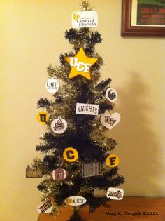 Christmas tree with homemade UCF ornaments. Manda could do this with her little tree.