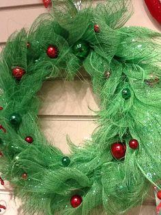 Shredded mesh wreath wreath that looks like holly