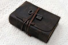 The Reliquary Journal - Distressed Dark Brown Leather Journal with Tea-Stained Pages, Vintage Key & Vintage Ink Stamps. $120.00, via Etsy.