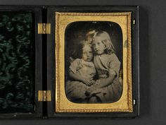 Unknown: Two small girls, posing in the style of J. M. Cameron, date unknown, ambrotype in case.