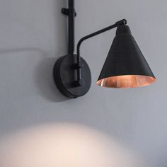 Saint Espresso coffee shop London. Interior design by NinaCo.  #lamp #wall #light #lowenergy #black #copper #cafe #cafedesigner #coffeeshop #coffee #espresso  NinaCo is a #design studio based between #London and #Amsterdam specialising in #interiors  #ceramics  Nina is an #interiordesigner with a focus on #sustainable design and #socialresponsibility