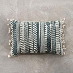 Finish off your room and make your space cozy with the addition of pillows and throws. These simple additions can make the biggest impact to your space year-round. Shop our collection of textured pillows and throws!
