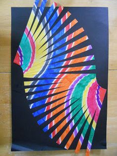 Colour a design on A4 paper, 'fringe cut' half the paper from one side, then half from the other, and glue on black paper. I can see a class set of these making a Rainbow Serpent on the back wall!