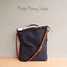 Convertible Waxed Canvas Tote with Leather Strap in Black, Wax Canvas Bag, Crossbody Cross Body Purse, Plus Size Foldover Bag, Made in USA by MondayMorningStudios on Etsy https://www.etsy.com/listing/251305965/convertible-waxed-canvas-tote-with