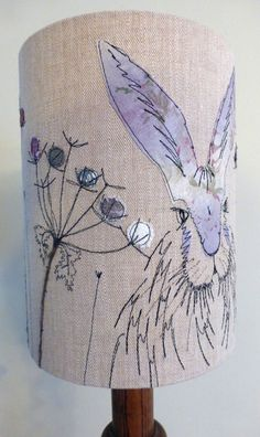 Lilac hare lampshade, measuring 20cm diameter x 30cm high. http://www.johilltextiles.co.uk/lampshades