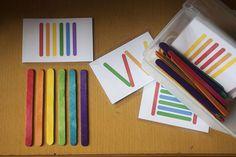 Palitos coloridos e cartões para seguir ordens de desenhos. Trabalha cores , discriminação visual , quantidades...