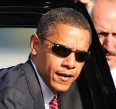 President Obama uses rimless narrow frames to offset his cheekbones and wide forehead with Ray Ban 3217