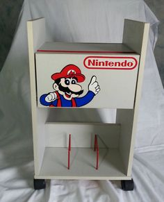 Check out this item in my Etsy shop https://www.etsy.com/ca/listing/226339341/nintendo-nes-storage-game-cabinet-80s