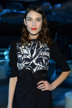 Alexa Chung rocks a bold red lip, front row at the Marc Jacobs show.