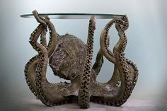 Give your home a cephalopod feel to it with this incredibly detailed metal octopus table. Weighing in at about 500 pounds, this metal octopus table took around 1500 hours to build and is a must have collector's piece for people who love unique furniture. Cool Tables, Cool Coffee Tables, Coffee Table Design, Cute Furniture, Cheap Furniture, Furniture Ideas, Table Furniture, Bedroom Furniture, Weird Furniture