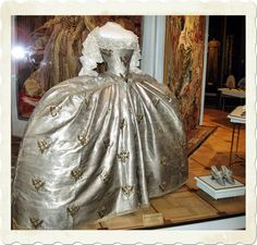 """Catherine the Great's Wedding Dress and Shoes.  (She started out with an 18"""" waist!)"""