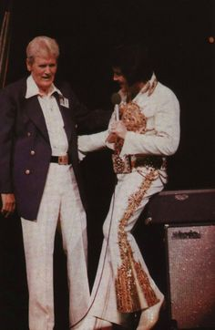 Elvis has Vernon come up on stage during His last concert in Indianapolis, IN June 26, 1977.