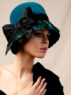 Golightly | Label: Lisa Tan Millinery | Autumn/Winter 2011 | Fur felt cloche with coque feather brim, tied with a silk dupion bow