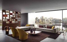 Das Regal besitzt Eigenschaften, die es vielfältig einsetzbar machen. Nicht nur als effiziente Ablagefläche für Bücher und andere präsentationswürdige Objekte auch als Raumteiler mit Struktur gebendem Charakter ist das Regal im Interieur unverzichtbar. Je nach Ausführung kann es sogar skulpturale Akzente setzen. Das Regalsystem Spazioteca von Pianca eignet sich als Raumteiler. Weitere Akteure im Bild: Sofa Duo und Couchtische Baio. © Pianca Outdoor Baths, Living Area, Living Room, Sophisticated Style, Recliner, Bookshelves, Cushions, Bedroom, Table