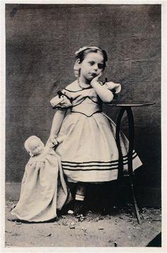 Petite fille en pied, tenant une poupée, 1865        by Achille Bonnuit