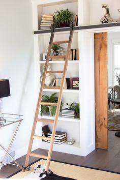 Beautiful ladder using sliding barn door hardware.