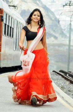 "Model turned actress Rakul preet singh latest lehenga pics from her upcoming telugu flick ""Loukyam"".Rakul preet is eye catchy in red lehenga,wore below nav Half Saree Lehenga, Red Lehenga, Sarees, Lehenga Blouse, Saree Dress, South Indian Actress Hot, Indian Actress Photos, Beautiful Bollywood Actress, Most Beautiful Indian Actress"