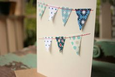 Using snippets of fabric to create pennants (bunting) on a handmade card