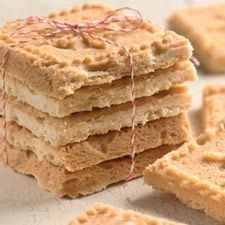 Shortbread. According to kingarthurflour, if you're having trouble pressing the shortbread flat in the pan because it's sticking to your fingers, cover it with a piece of plastic wrap, and push on the wrap. Remove the wrap before baking.