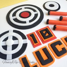 Targets and darts fondant cake toppers. Made by FancyTopCupcake