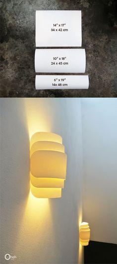 Lámpara de pared con papel doblado