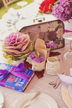 Tables were decorated with old books, vintage-inspired luggage, and teacups and jars, which were used to hold flora.