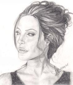 Mi Querida Angelina Jolie en una pose inusual que capté de una fotografia suya...