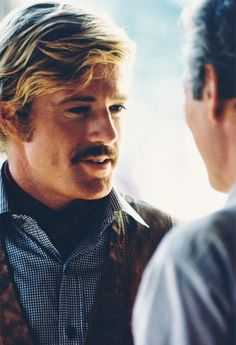 Robert Redford speaking to Paul Newman on the set of Butch Cassidy and the Sundance Kid, 1969.