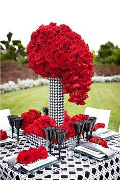 LA Premier Floral Design, Elevated floral centerpiece of red roses in a modern black and white vase.