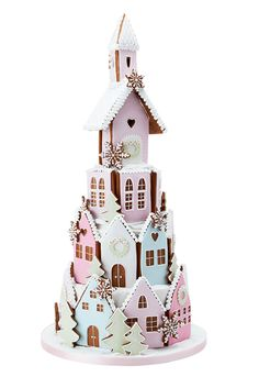 Inspired by Peggy's family visits to Christmas markets in a medieval snow-covered mountain village, this candy-coloured Gingerbread Village is an extraordinary show-stopping centrepiece. With a heavenly scent of sugar and spice, this edible winter wonderland hides three (two for the small version) indulgent tiers of rich dark fruit cake covered with marzipan and royal icing, plus a two tier gingerbread church, perfect for devouring on Christmas day.