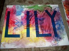 Painters tape on a canvas and kid-applied fingerpaint make for a great name craft.