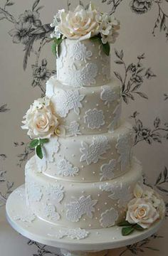 ivory and white lace effect wedding cake with flower detail