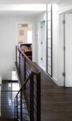 industrial metal stairs and railing - nice lines. Love the floor color and the lines of the railing rather than up and down Metal Stairs, Metal Railings, Staircase Railings, Stairways, Black Banister, Interior Decorating Styles, Interior Design, Brick Ranch Houses, Interior Stairs