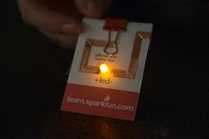 Make a paper circuit pin with copper tape, LED, and a binder clip!