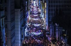 People march down Istiklal Avenue to mark International Women's Day in Istanbul, Turkey. (Bulent Kilic / AFP)