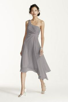 Timeless, elegant and chic, this short crinkle chiffon dress will be your bridesmaids new go to staple dress long after the wedding reception! One shoulder neckline features ultra-feminine ruched bust. Soft twist cascade bodice and asymmetrical hemline gives this dress a whimsical feel. Fully lined. Back zip. Imported polyester. To protect your dress, try our Non Woven Garment Bag.