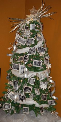 This is my Scrapbooked Christmas Tree that I started making last Christmas. The ornaments are made with pictures from the previous year. The kids are already excited to see how this year's tree turns out!