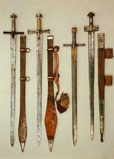 "Three SUDANESE ""kaskara"" swords, Sudan, and a TUAREG ""takuba"" sword, Mali."