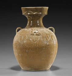"""Chinese Jin Dynasty Glazed Pottery Vessel; of bottle form with wide rimmed mouth; incised lotus petal design and molded equestrians, two loop handles (glaze somewhat degraded); H: 10 1/4"""""""